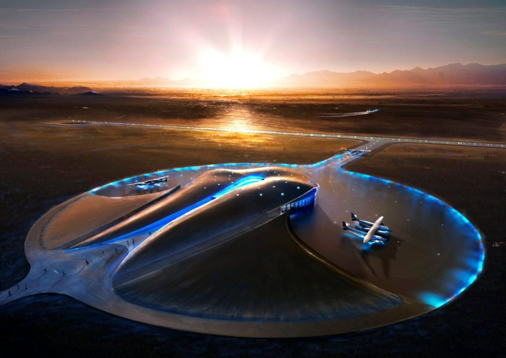 Aerial view of Virgin Galactic Space Port at dusk with blue runway lighting