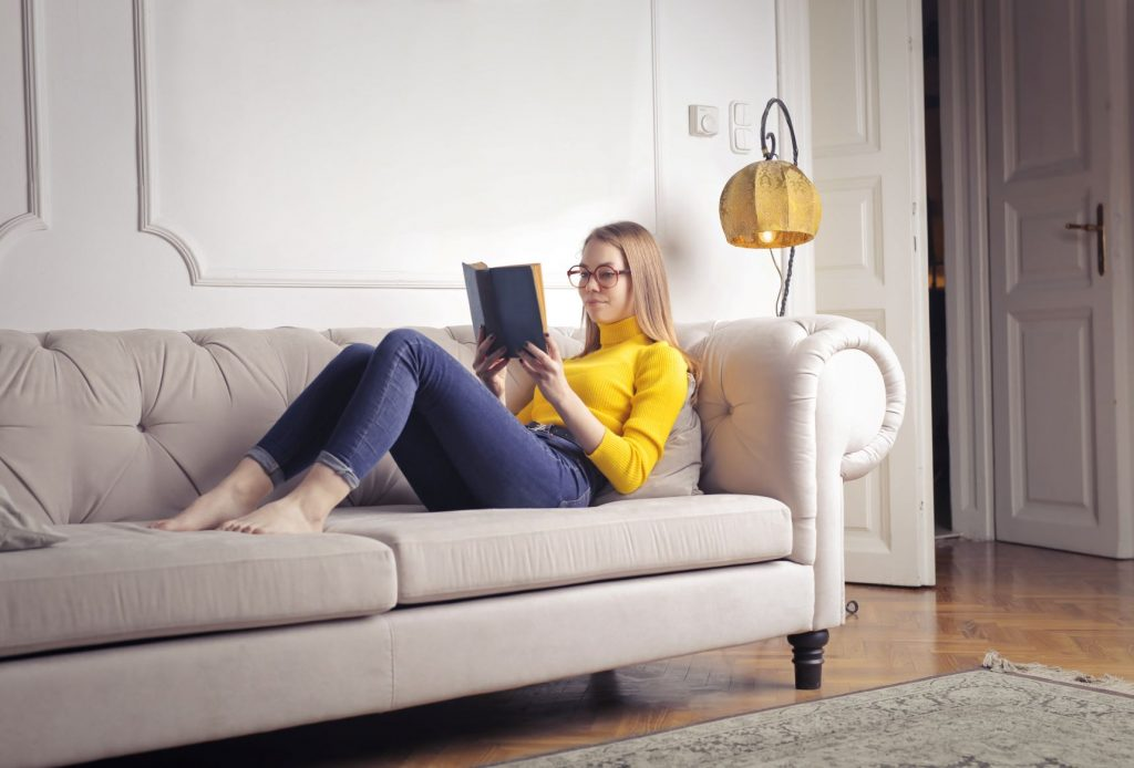 Woman reading on a lounge chair